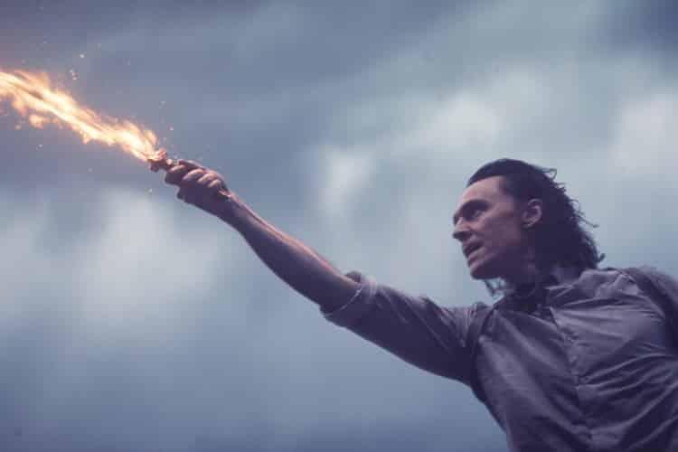 Loki (Tom Hiddleston) with flaming sword in Loki Season 1